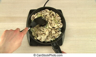 Chopped onion frying on vegetable oil top view - Chopped ...