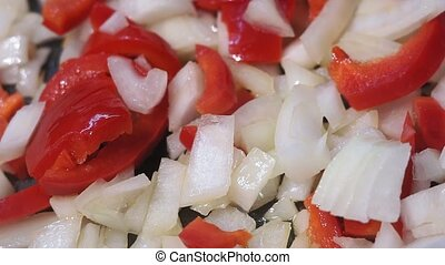 Chopped onions, red pepper fried in vegetable oil in the pan...