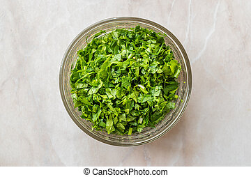 Chopped Parsley in Glass Bowl for Salad.
