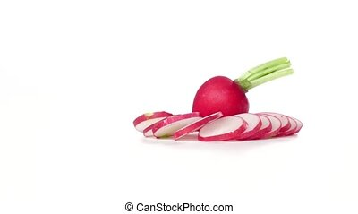 Chopped radish revolve around a whole fresh radish. White...