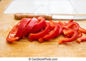 Chopped red bell pepper on a cutting board