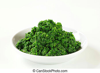 Bowl of chopped spinach - studio