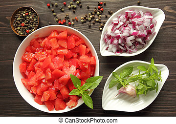 Chopped tomatoes. - Bowls with chopped raw tomatoes and...