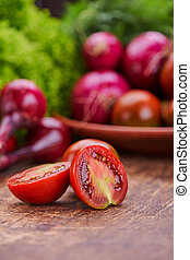 Chopped tomatoes on a background of vegetables