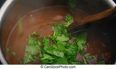 Chopped Vegetable Added To Meat Stew - Chopped vegetable is...