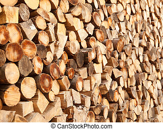 Chopped wooden logs. Rural and natural background theme