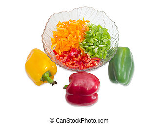 Chopped yellow, red and green bell peppers and whole peppers