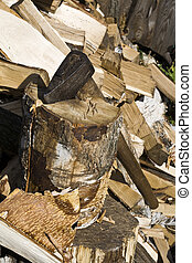 chopper - An old wood handled axe with chopped firewood ...