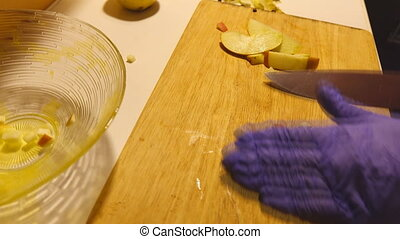 Chopping apple on chopping board