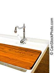 Chopping board - Wooden chopping board on a kitchen sink