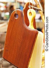 chopping boards hanging on a rope