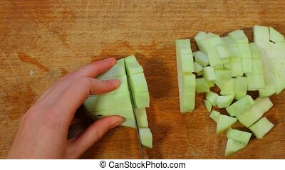 Chopping eggplants for cooking - Chopping eggplants on...