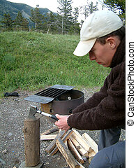 man chopping wood.