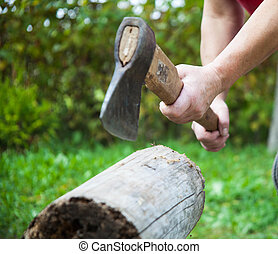Chopping firewood in the open air.