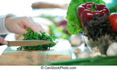 Chopping herb parsley - Women hands slice herb parsley