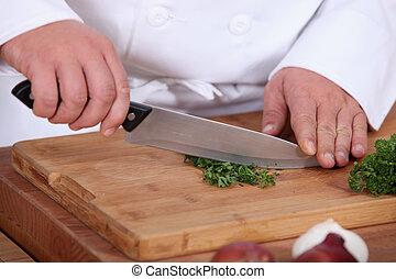 Chopping parsil.
