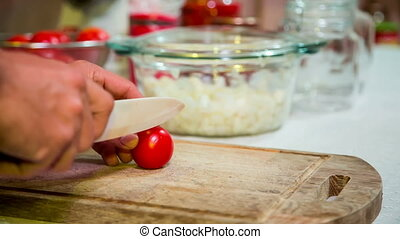Chopping Tomatoes In The Kitchen