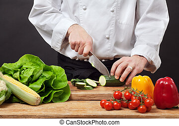 Chopping vegetables - Photo of a chef chopping vegetables on...