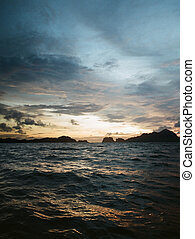choppy sea at dusk - Dusk of a stormy day in Philippines,...
