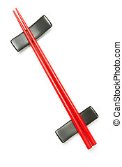 Two red wooden chopstick on holder over white