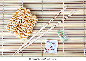 chopsticks and noodles - photo shot of chopsticks on bamboo...
