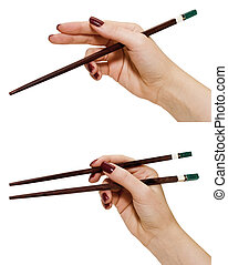 chopsticks in a hand; isolated on white