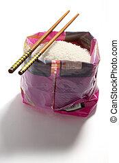 Chopsticks on Bag of Rice
