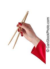 chopsticks on hand - chopsticks isolated on white background