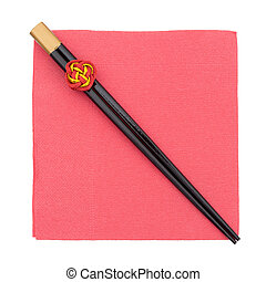 Chopsticks on red plate, isolated on white, with copyspace.