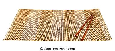 Chopsticks over a bamboo mat