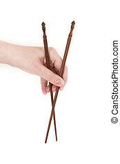 chopsticks over white