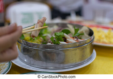 Chopsticks to eat chinese seafood food