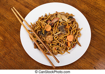 Chopsticks with Lo Mein on White Plate