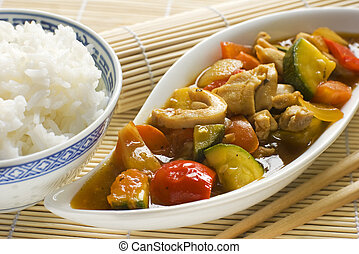 chopsuey - asian chop suey with chicken and rice close up