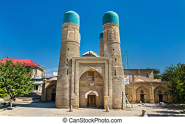 Chor Minor, Four Minarets Madrasah in Bukhara, Uzbekistan. -...