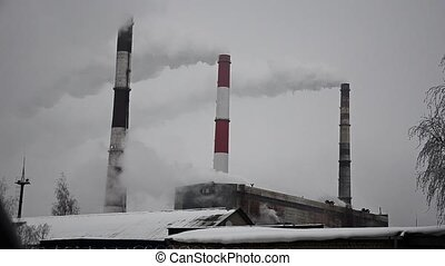 CHP in heavy snow. Cogeneration plant. The work of a thermal power plant in winter. CHPP