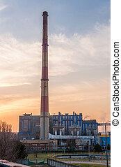 CHP with high chimneys at dusk
