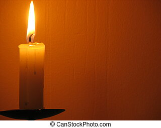 candle in yellow light