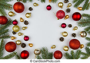 Chrismas frame. Christmas composition made of golden and red balls for a Christmas tree, and fir branches. Winter flat lay.