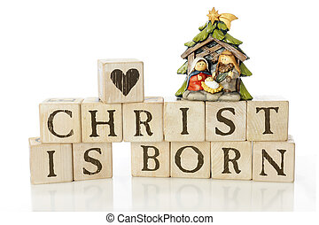 "Christ Is Born - Rustic alphabet blocks arranged to say, ""..."