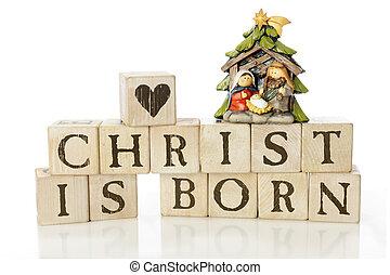 Christ Is Born - Rustic alphabet blocks arranged to say,...
