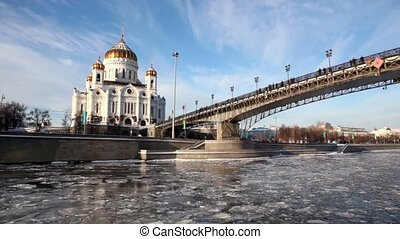 Christ Savior Cathedral and Patriarchal Bridge at winter in...