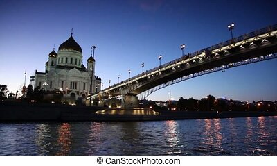Christ Savior Cathedral and Patriarchal Bridge at evening in...