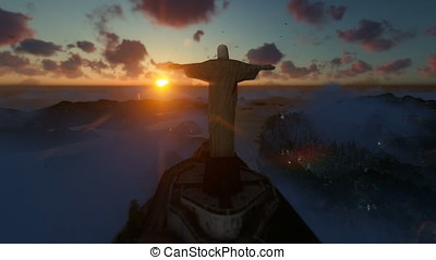 Christ the Redeemer above clouds at sunset, Rio de Janeiro, drone panning