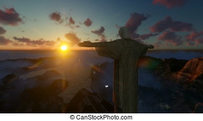 Christ the Redeemer above clouds at sunset, Rio de Janeiro,...