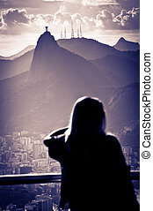 Christ The Redeemer at sunset - Person looking at sunset...