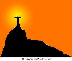 Silhouette of a statue to Jesus Christ in Rio de Janeiro Brazil on an orange background