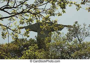 Christ the redeemer statue with branches infront