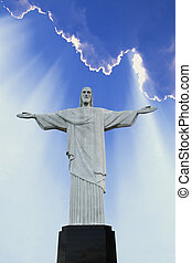 Christ The Redeemer statue sits atop the Corcovado mountains...