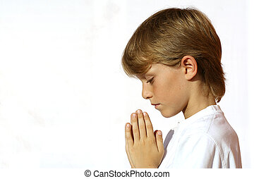 christian child praying  hands clasped in prayer